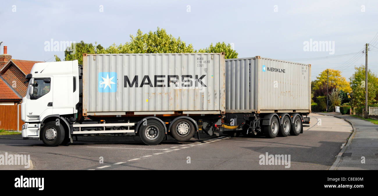 Transport logistics hgv container lorry truck towing trailer loaded with Maersk shipping containers reversing in Stock Photo