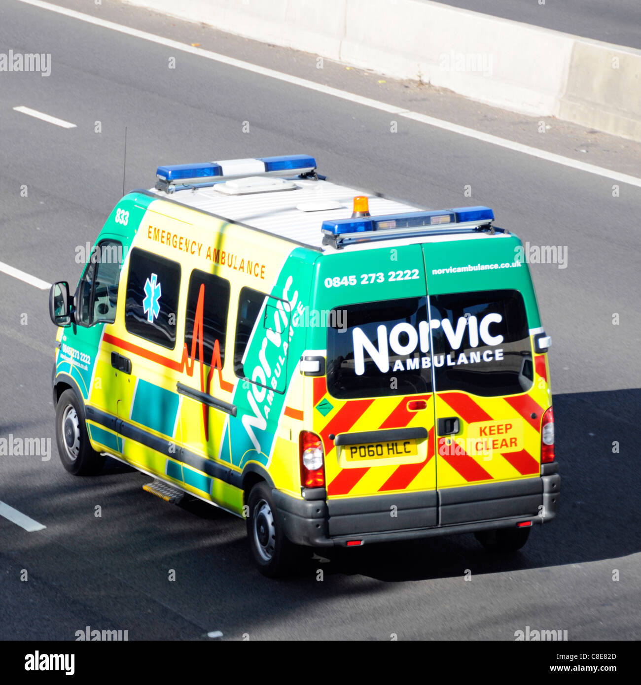 Norvic private sector emergency health care ambulance business driving along M25 motorway Essex England UK - Stock Image