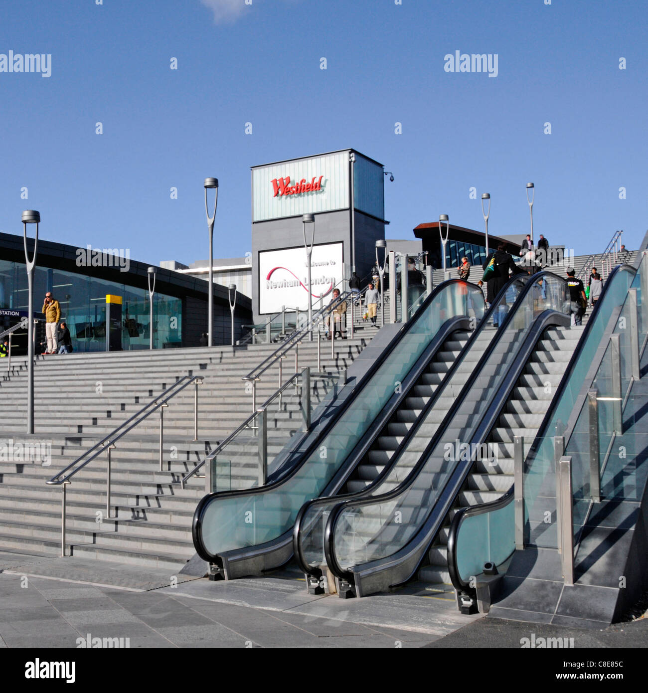 Early morning view stone steps with handrails & outdoor escalators leading to the Westfield shopping malls at - Stock Image