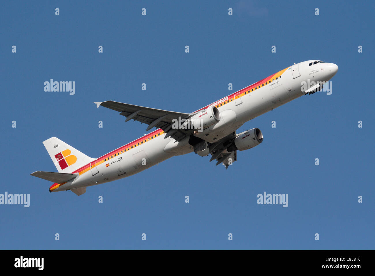 Iberia Airbus A321 passenger jet airliner climbing on takeoff against a clear blue sky - Stock Image