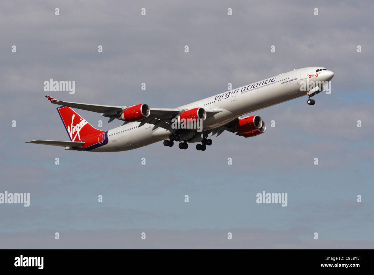 Long haul air travel. Virgin Atlantic Airways Airbus A340-600 airliner departing from London Heathrow - Stock Image