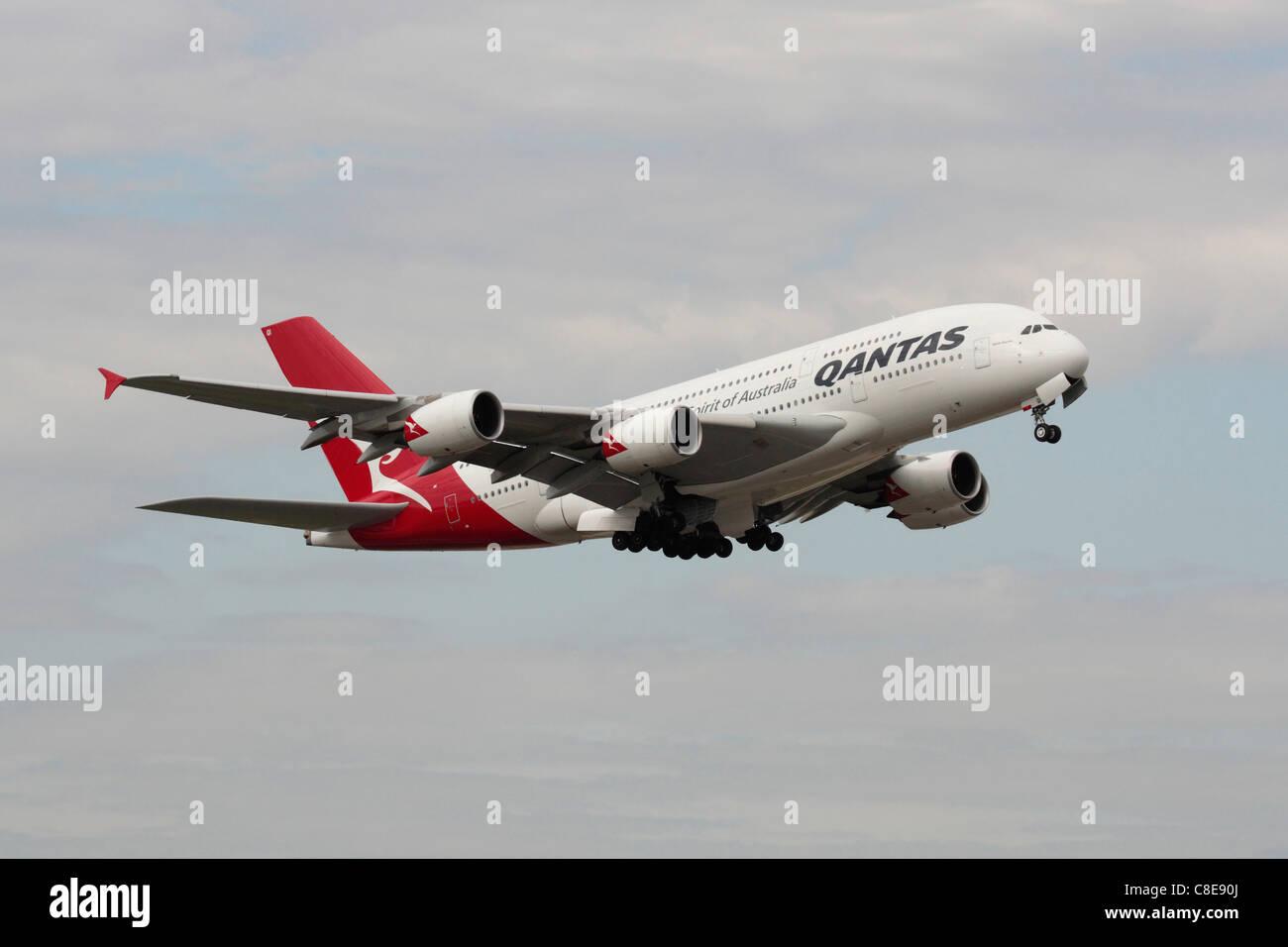 Qantas Airbus A380 superjumbo departing from Heathrow on a long haul intercontinental flight - Stock Image