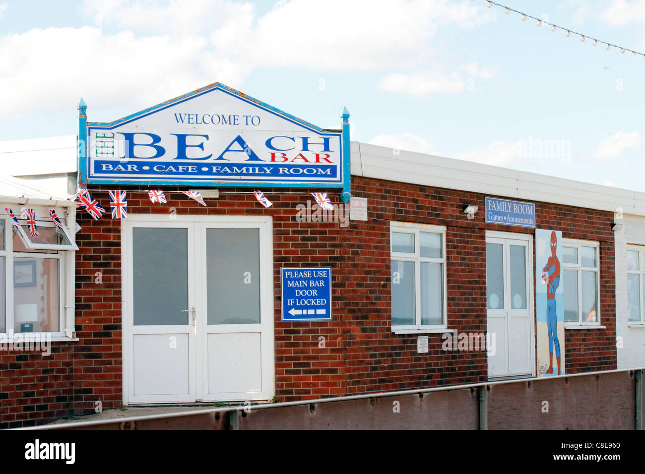 The beach at Sutton-on-Sea. Welcome to the beach bar café family room - Stock Image