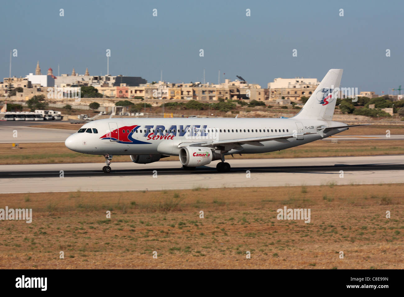Travel Service Airbus A320 accelerating on the runway for departure from Malta - Stock Image