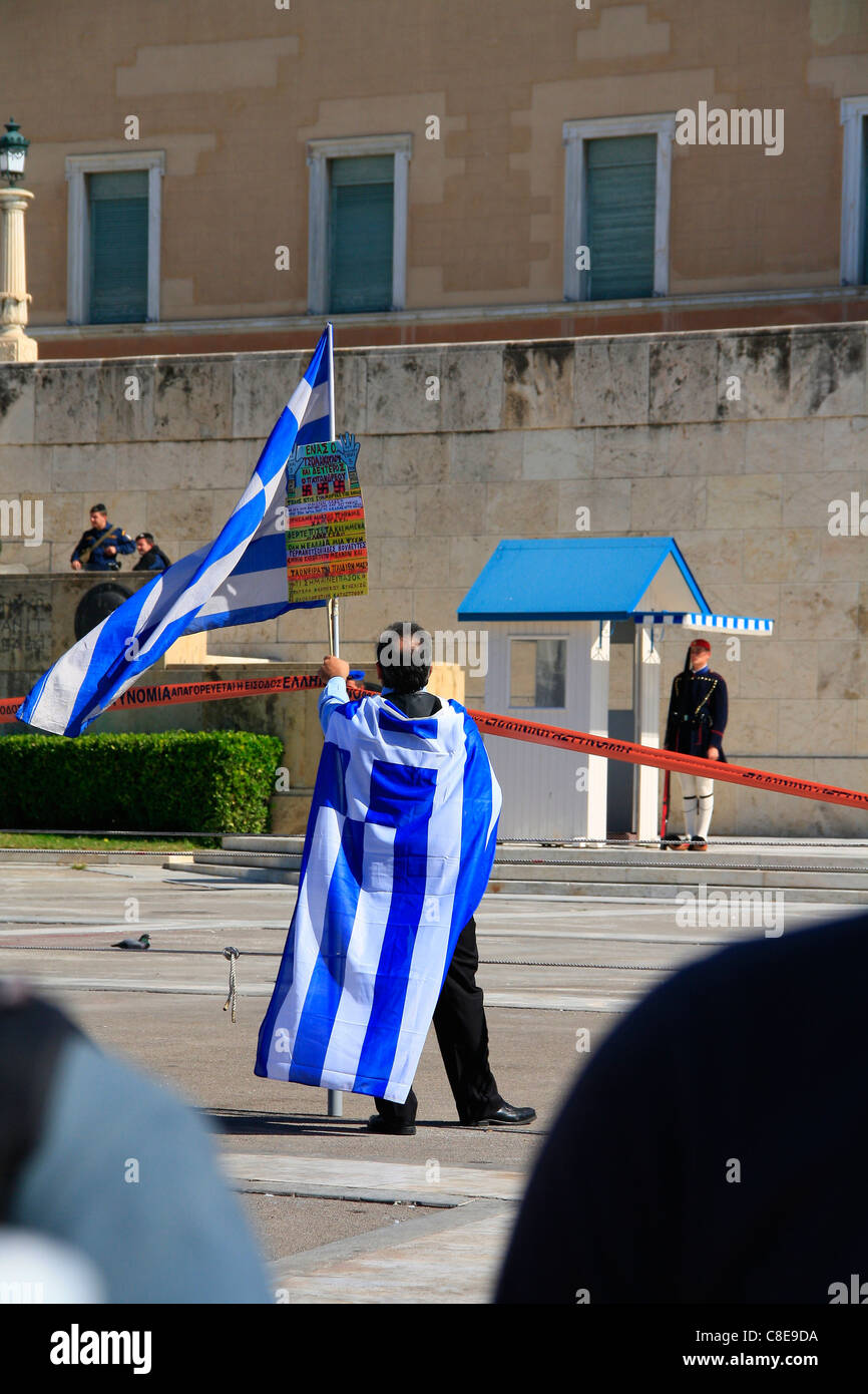 ATHENS, SYNTAGMA SQUARE, 20/10/2011. Protests against Greek government's economic policy. Protester in front - Stock Image