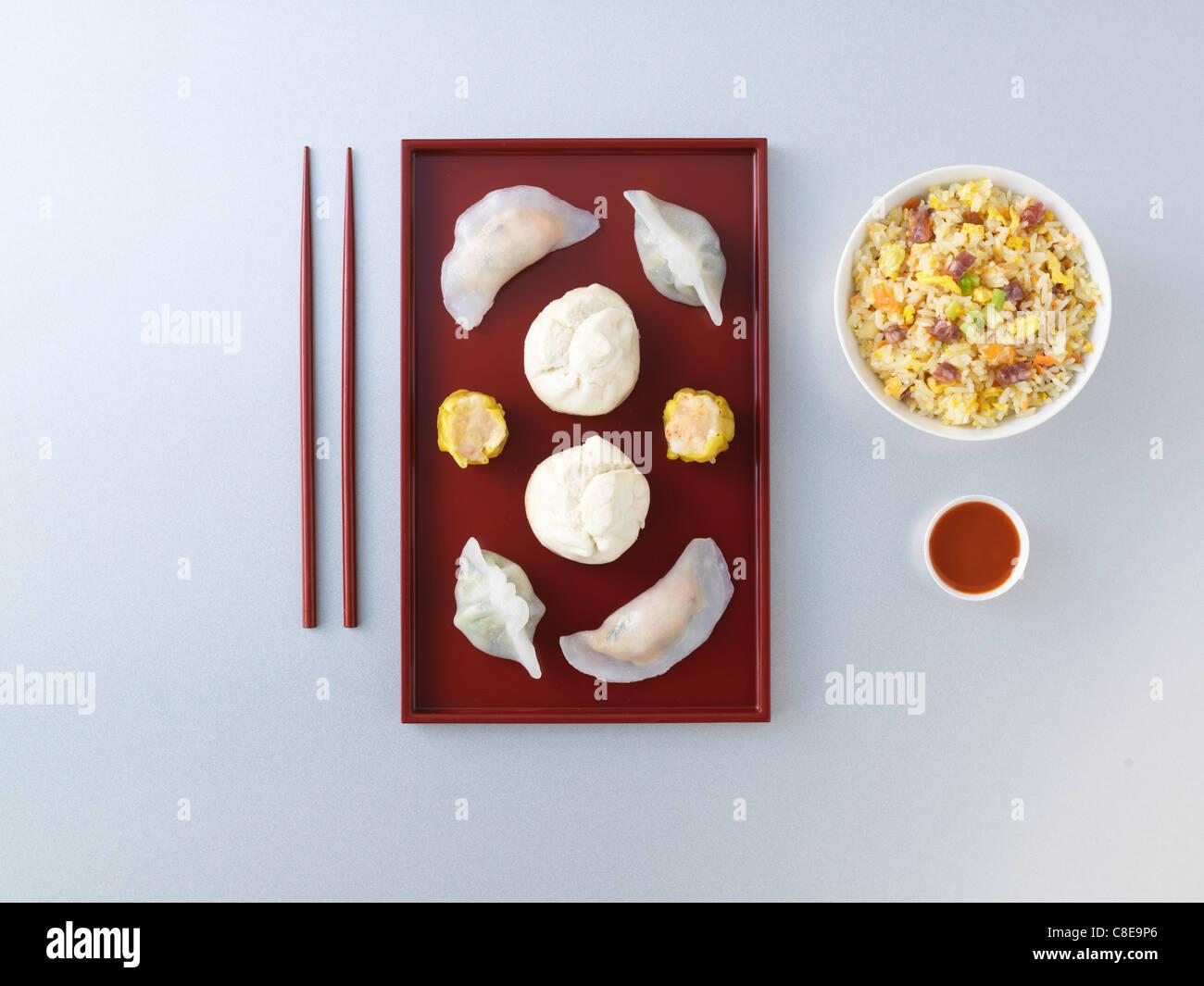 Asian raviolis and Cantonese rice - Stock Image