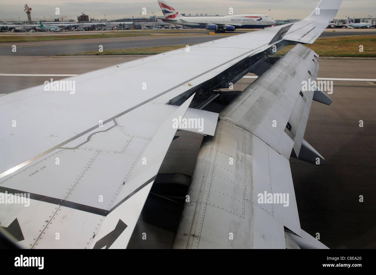 An  aeroplane wing configured for landing - Stock Image
