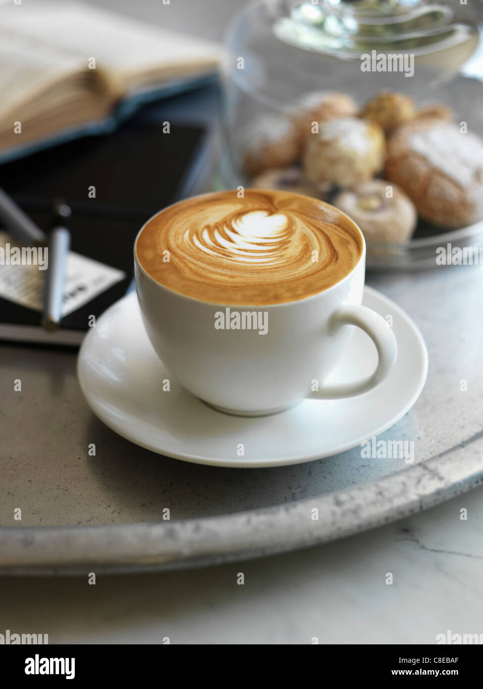 Cup of Cappuccino and amarettis - Stock Image