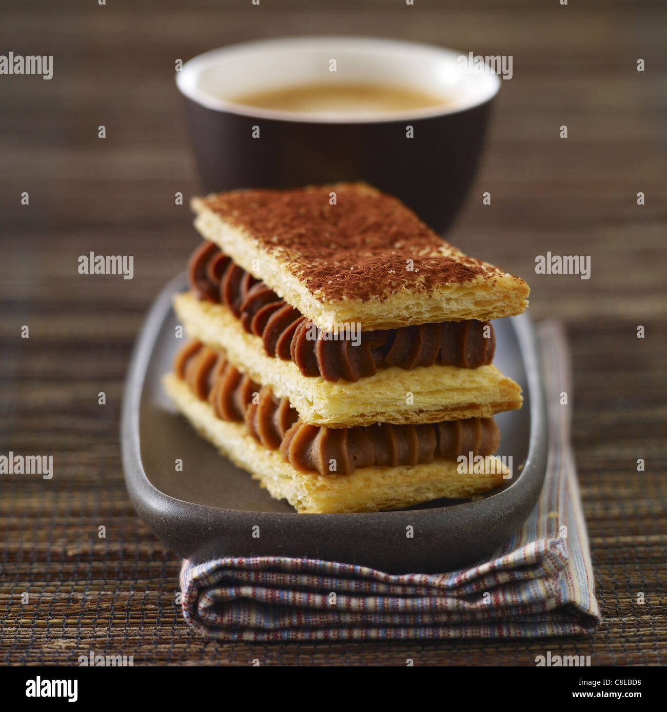 Almond-flavored cream and chocolate cream Mille-feuille - Stock Image
