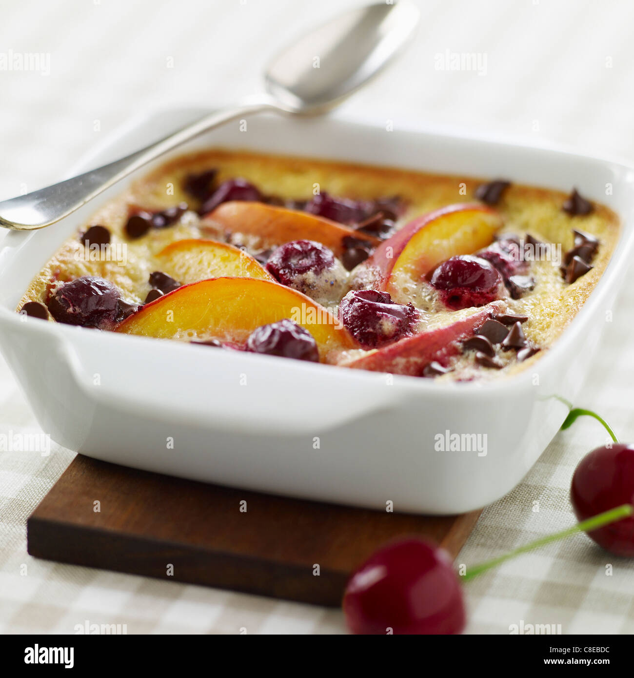 Nectarine,cherry and chocolate chip batter pudding - Stock Image