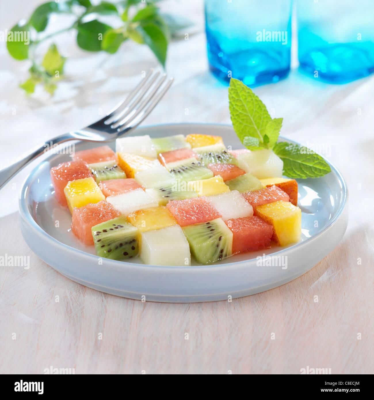 Checked fruit salad - Stock Image