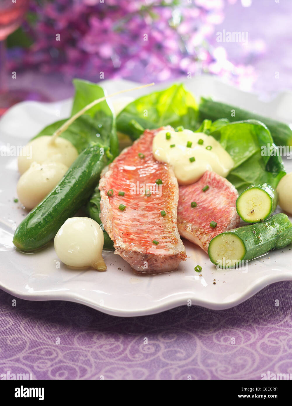 Red mullet fillets with white butter sauce,zucchinis,turnips and onions - Stock Image