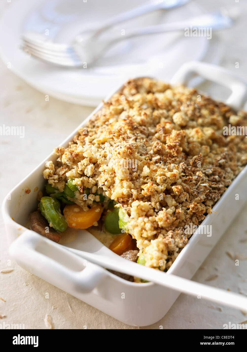 Lamb and vegetable savory oat crumble - Stock Image