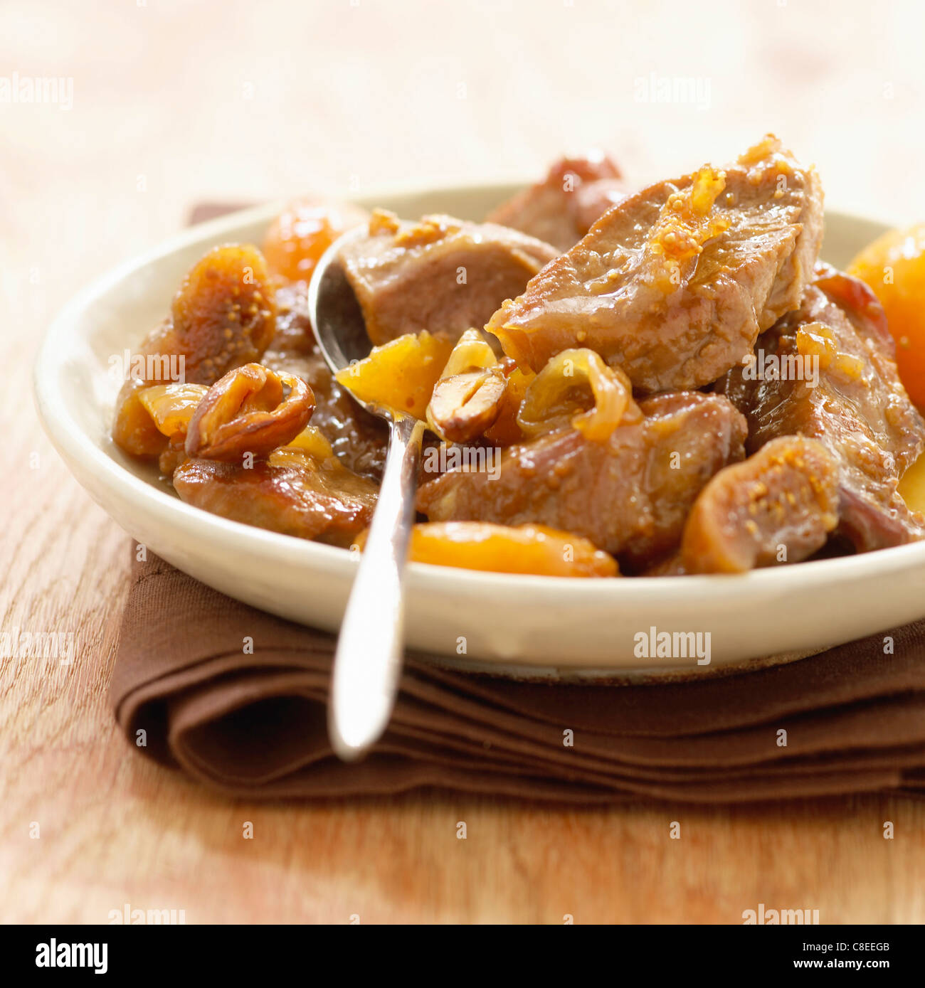 Bourbonnais lamb stew with dried fruit and onions Stock Photo