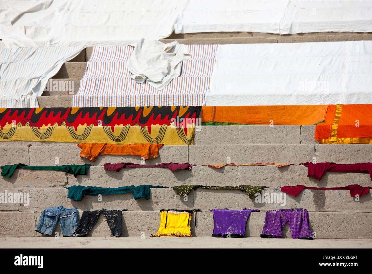 Laundry on the steps of the Ghats by The Ganges River at Kali Ghat in City of Varanasi, Benares, India - Stock Image