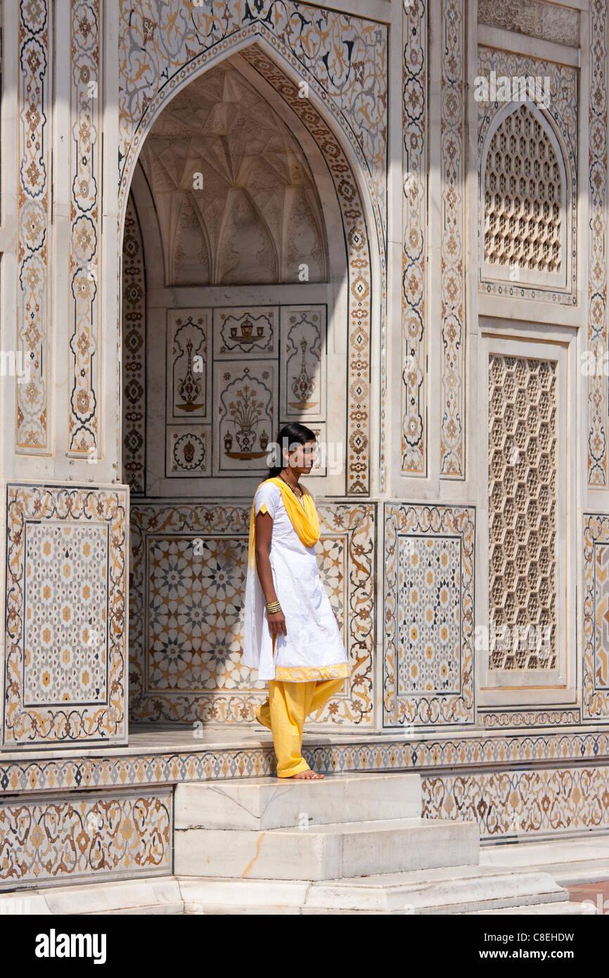 Muslim Punjabi girl at Tomb of Etimad Ud Doulah, 17th Century Mughal tomb built 1628, Agra, India - Stock Image