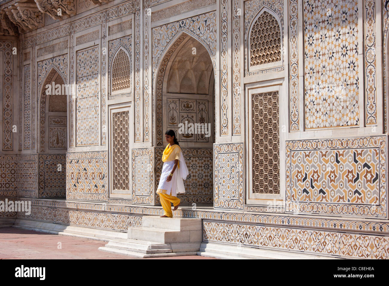 Muslim Punjabi girl at Tomb of Etimad Ud Doulah, 17th Century Mughal tomb built 1628, Agra, India - Stock Image