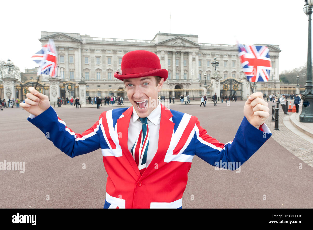 British patriotic royalist waves his flags at Buckingham Palace - Stock Image