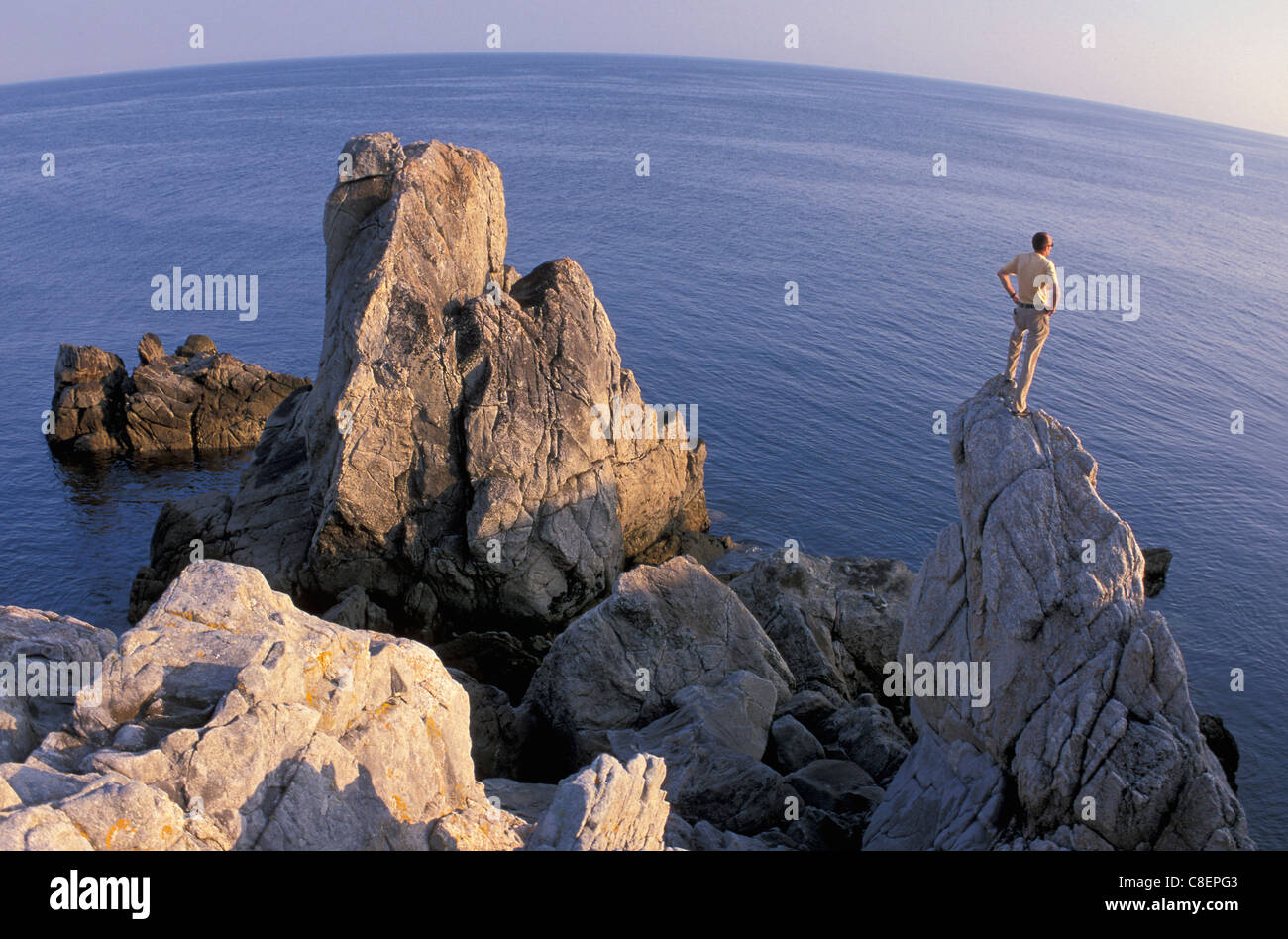 Coast, near Le Croisic, Brittany, France, Europe, rocks, sea, person Stock Photo