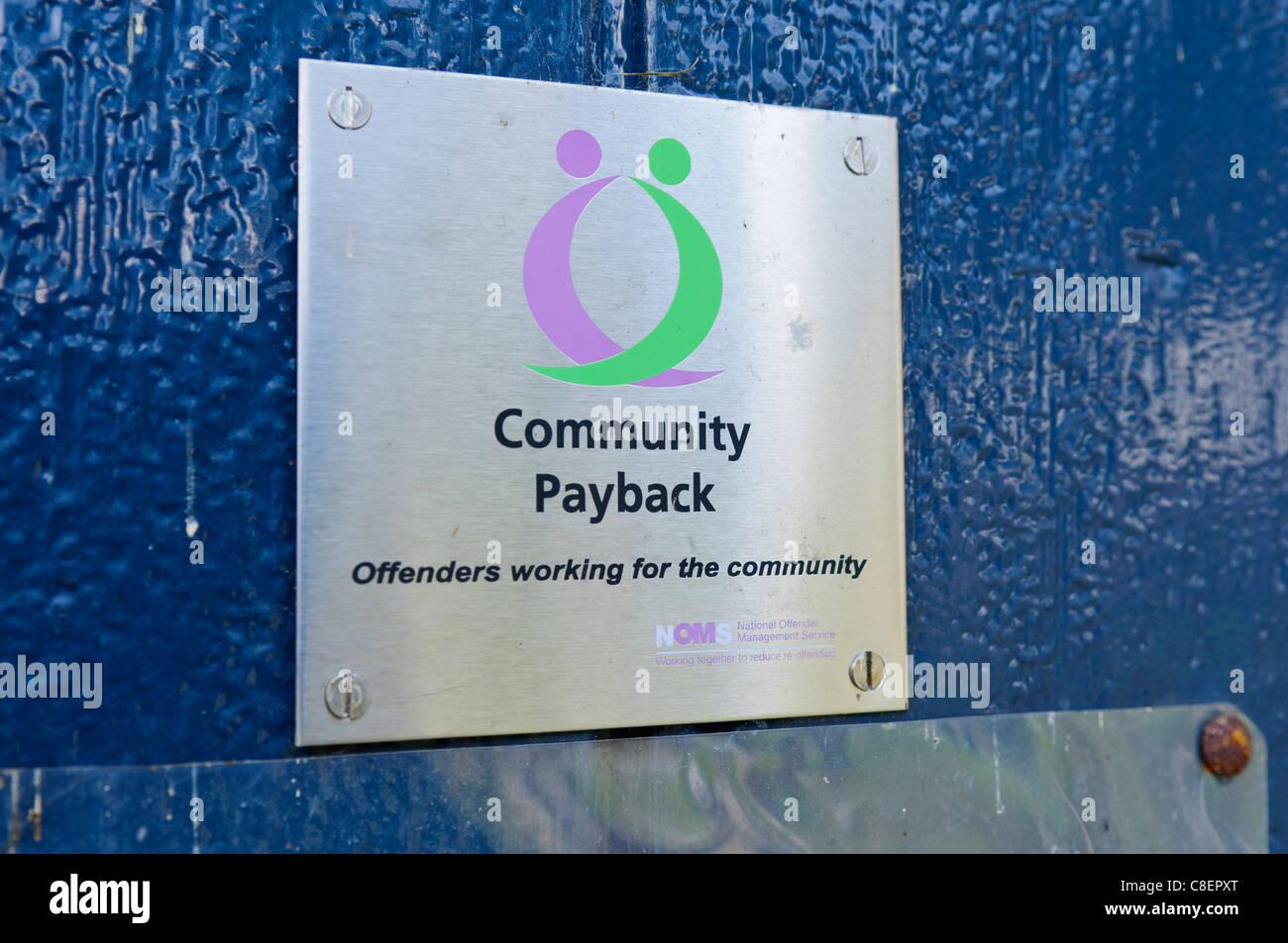 Community Payback sign - Stock Image