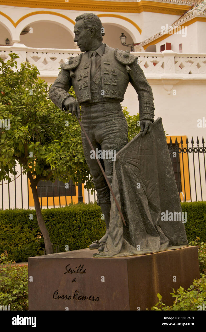 Statue of famous torrero Curro Romero in front of Plaza de Toros, La Maestranza, Seville, Andalucia, Spain Stock Photo