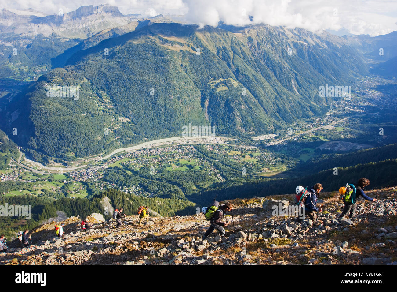Hikers above Chamonix Valley, Mont Blanc Massif, French Alps, France Stock Photo