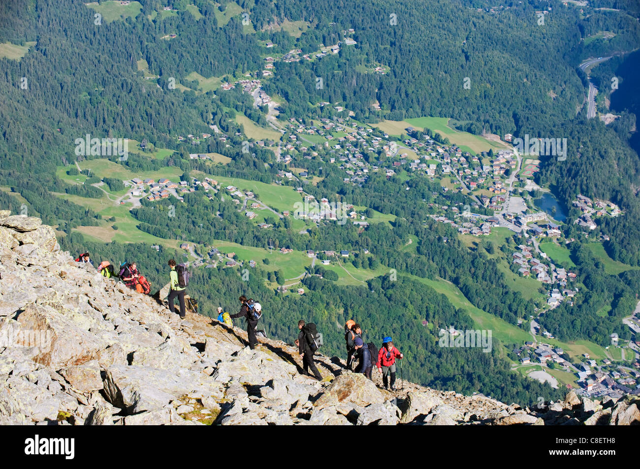 Hikers above Chamonix Valley, Mont Blanc Massif, French Alps, France - Stock Image