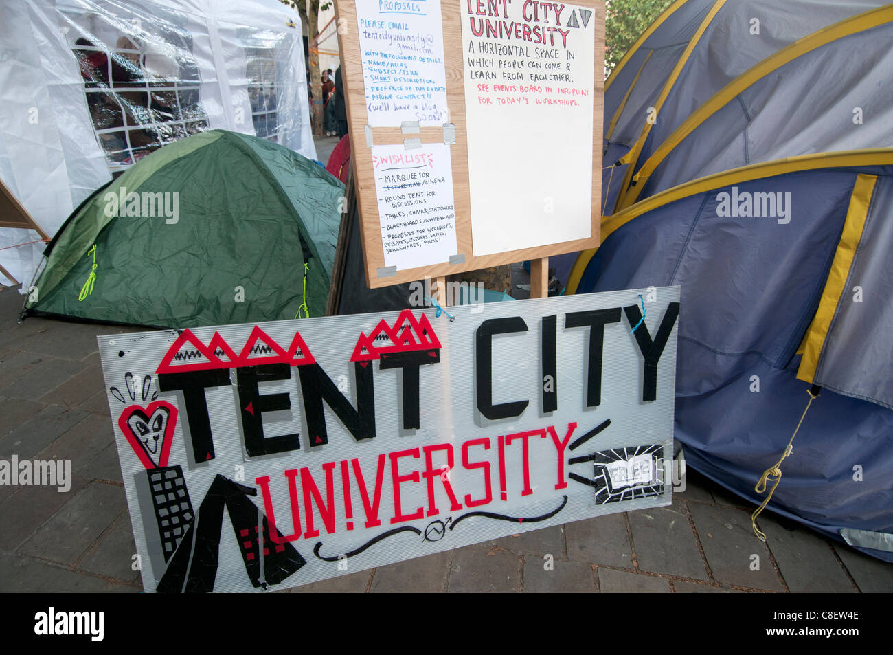 Occupy the London Stock Exchange camp in front of St Paul's to protest at economic situation.The tent university - Stock Image