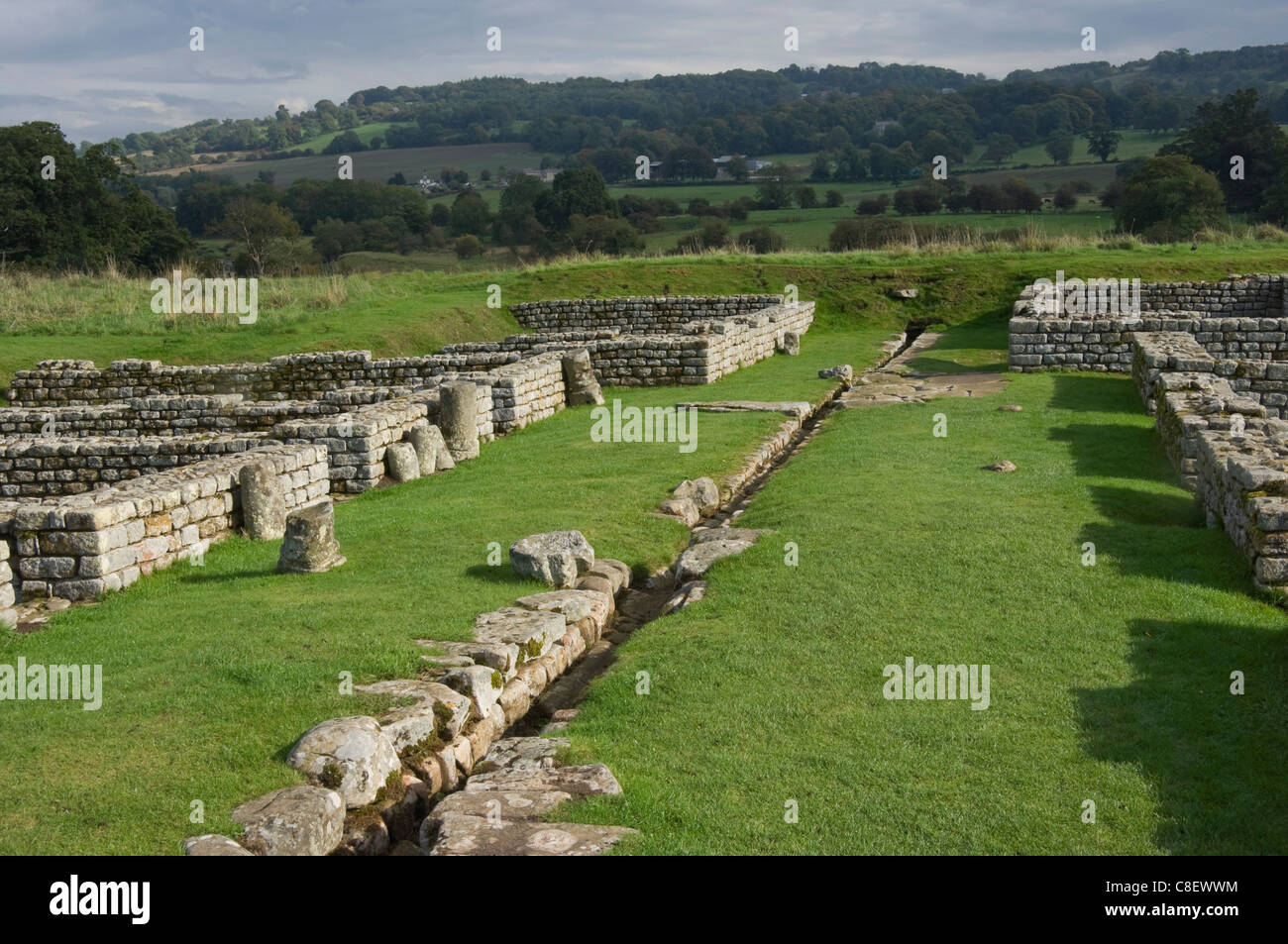 Drainage channel & barrack blocks, Chesters Roman Fort, Hadrians Wall, UNESCO World Heritage Site, Northumbria, - Stock Image