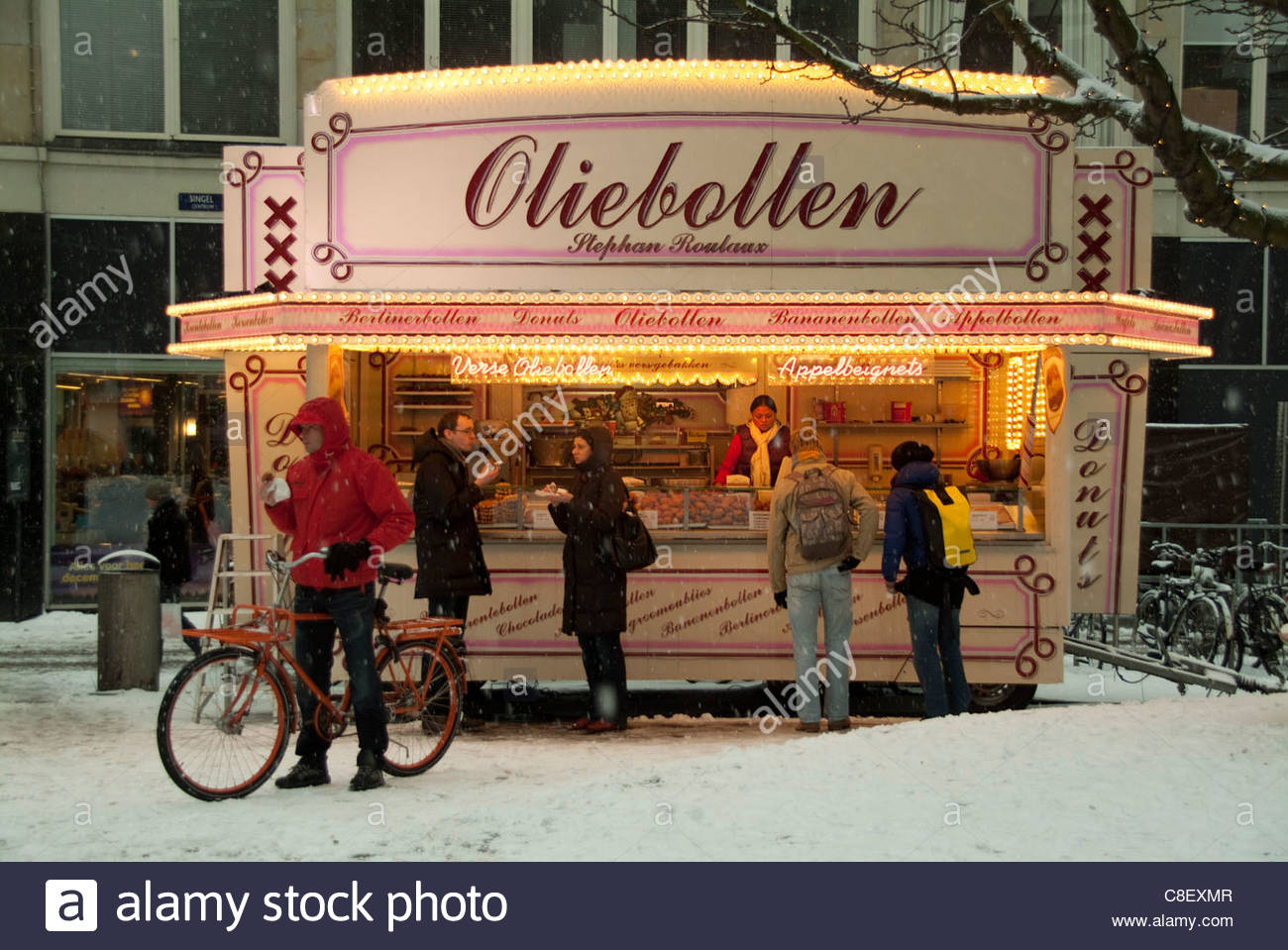 A waffle stand in snow at Christmastime. - Stock Image