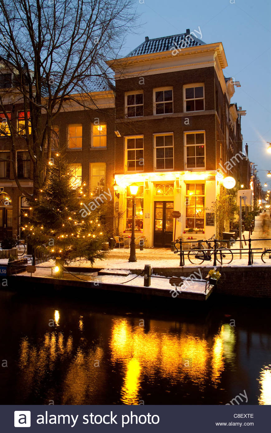 Snow along a canal at Christmastime. - Stock Image