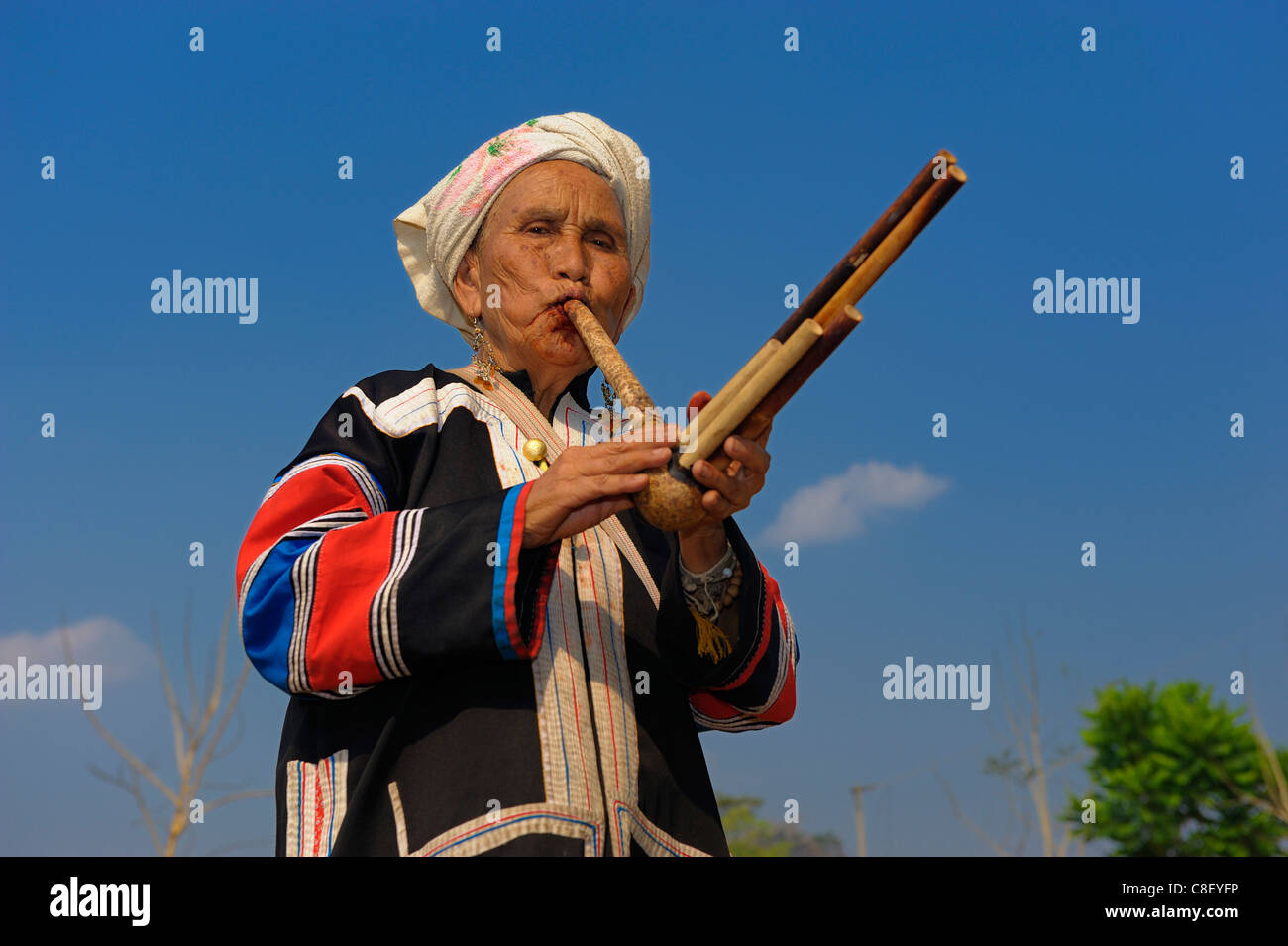 Hilltribe woman, Lahu tribe, near Pai, Thailand, Asia, music, instrument - Stock Image