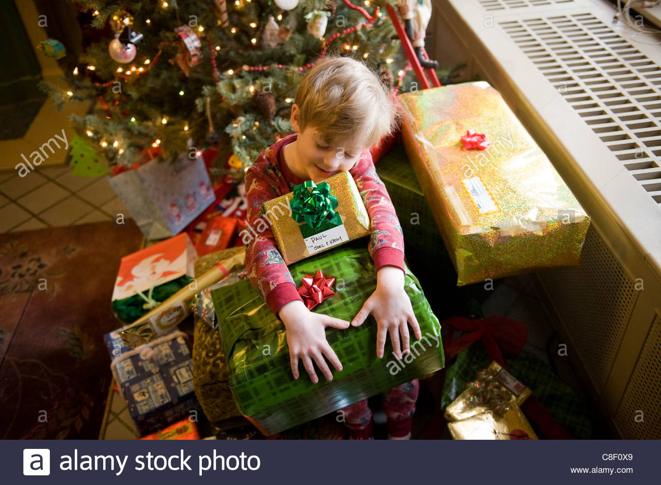 A 5-year-old boy with his Christmas presents in Lincoln, Nebraska. Nebraska