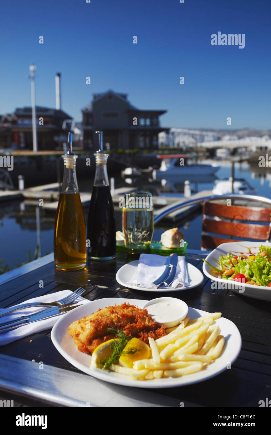 Fish and chips at outdoor restaurant, Thesen's Island, Knysna, Western Cape, South Africa - Stock Image