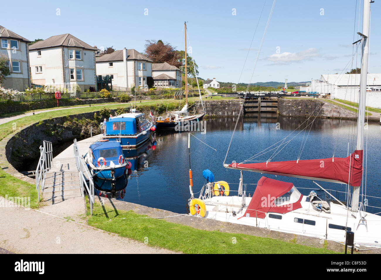 The basin on the Crinan Canal above the lock at Ardrishaig, Argyll & Bute, Scotland, allowing access to Loch Gilp Stock Photo