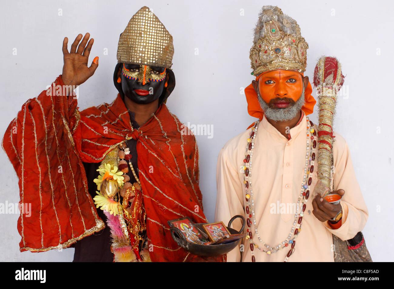 Female sadhu (sadhvia) impersonating goddess Kali & male sadhu impersonating god Hanuman at Haridwar Kumbh Mela, - Stock Image