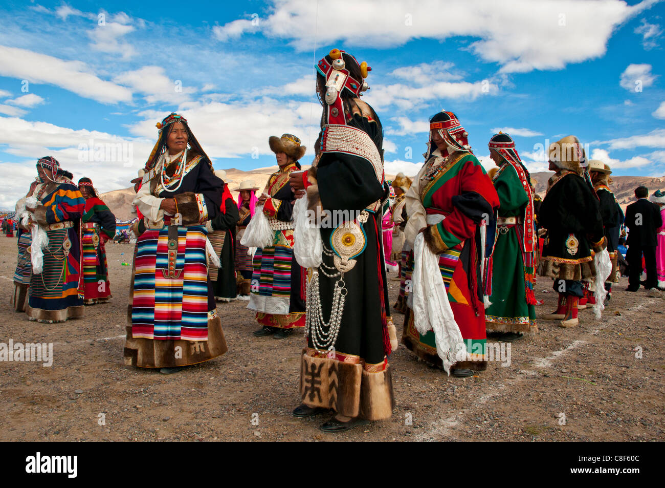 Traditionally dressed Tibetans participating at a local festival, Gerze, Tibet, China - Stock Image