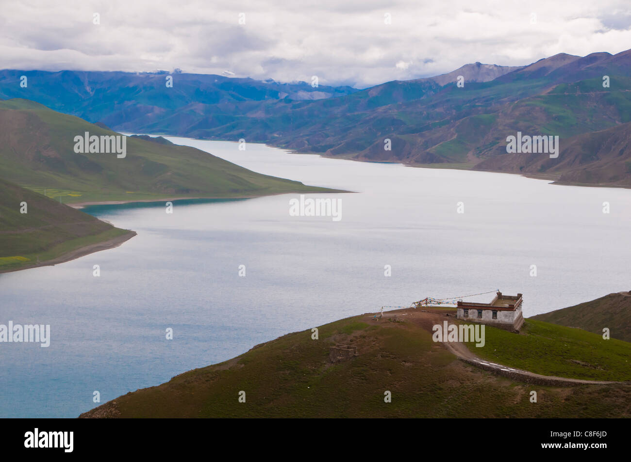 View over Yamdrok Lake one of the three largest sacred lakes in Tibet, Tibet, China - Stock Image