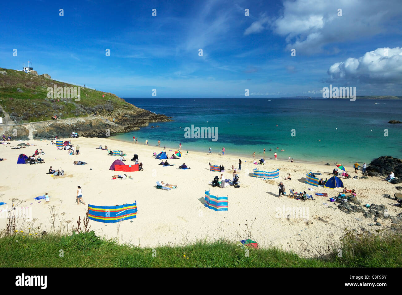 Families enjoy the sea, sand and summer sunshine, Porthgwidden beach, St. Ives, Cornwall, England, United Kingdom - Stock Image