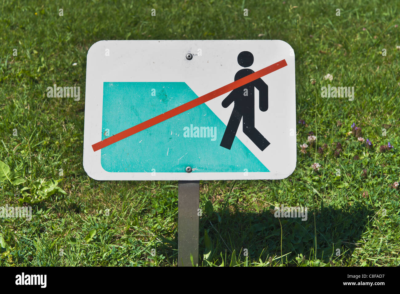 Detail photo of a sign Keep off the grass! - Stock Image
