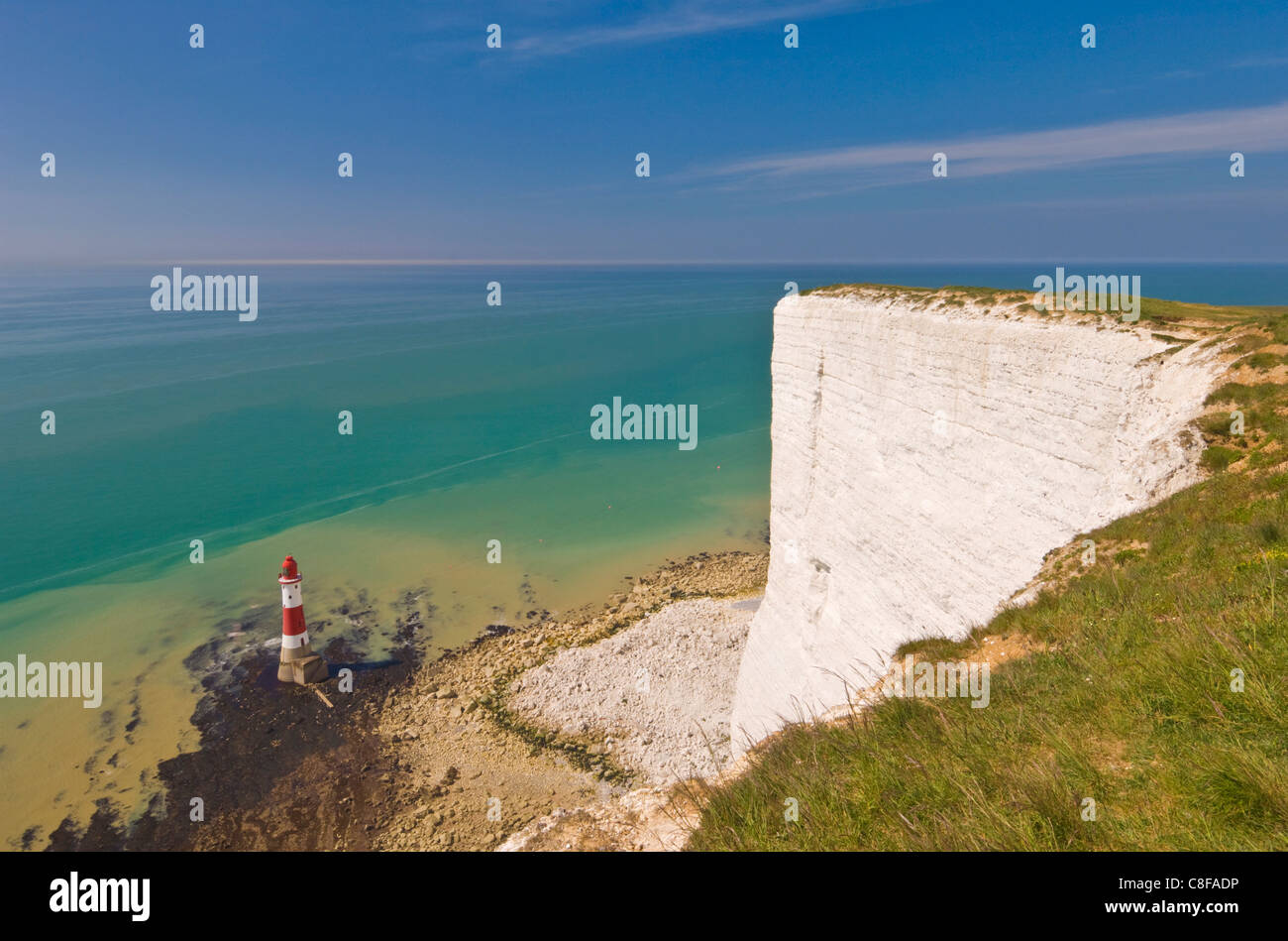 Beachy Head lighthouse, white chalk cliffs and English Channel, East Sussex, England, United Kingdom - Stock Image