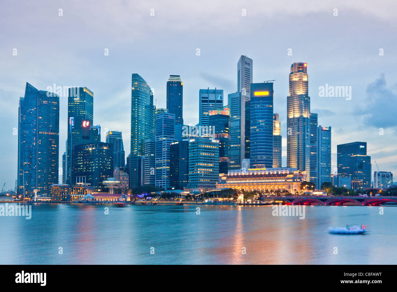 Singapore, Asia, Downtown, blocks of flats, high-rise buildings, evening, lights, illumination, dusk, twilight, - Stock Image