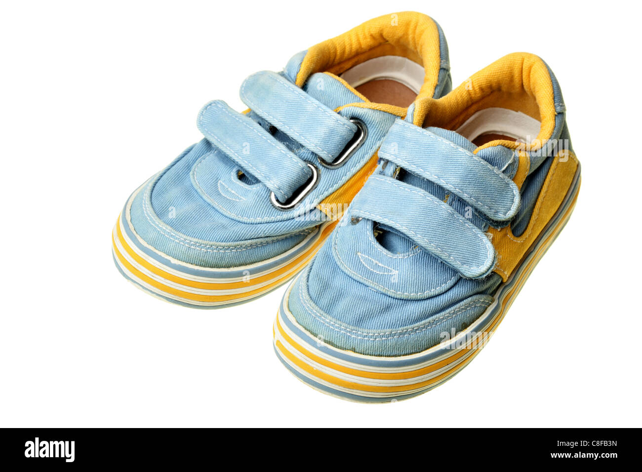 Children's shoes isolated over the white background - Stock Image