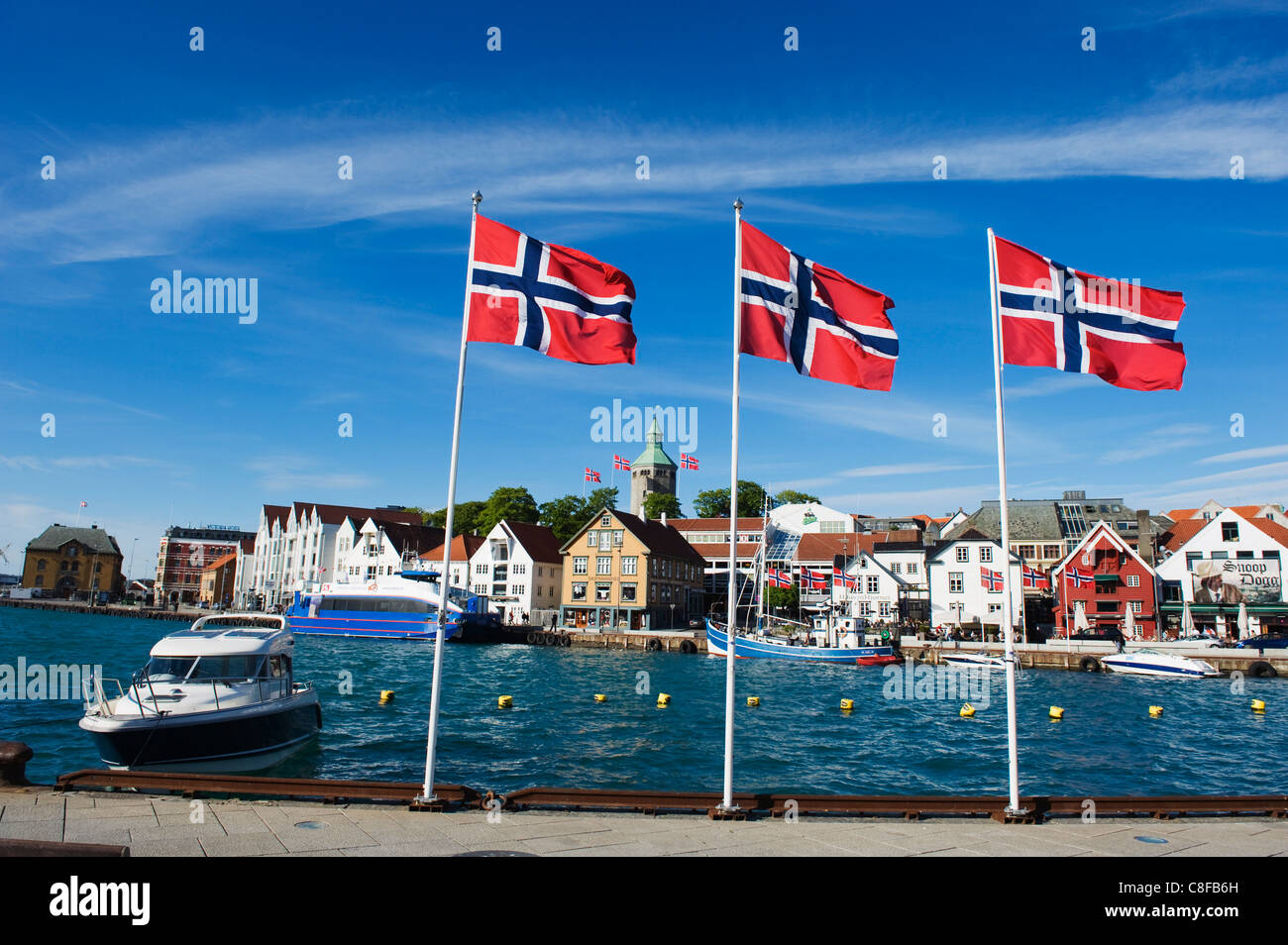 Norwegian flags and historic harbour warehouses, Stavanger, Norway, Scandinavia - Stock Image