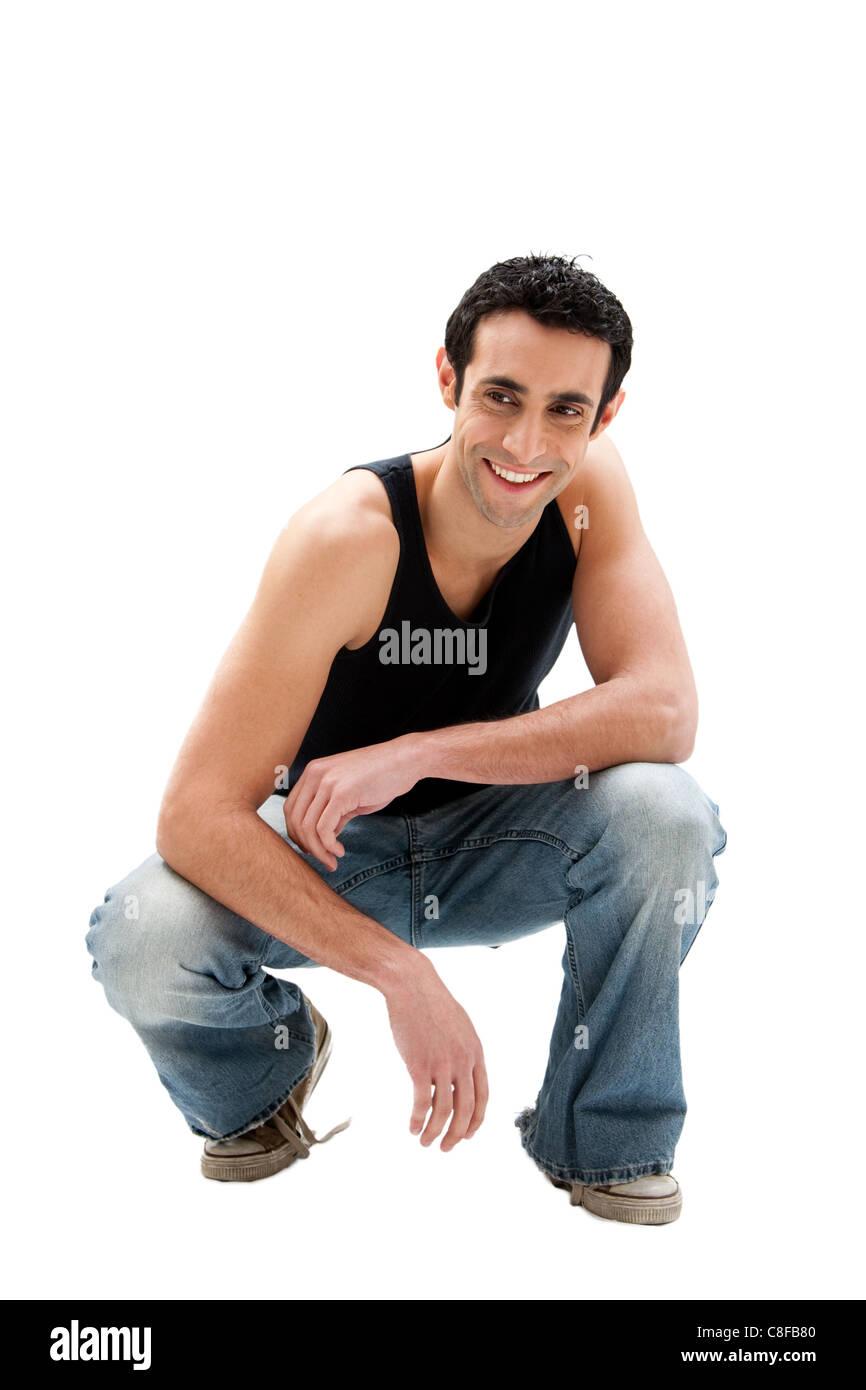 Handsome guy squatting - Stock Image