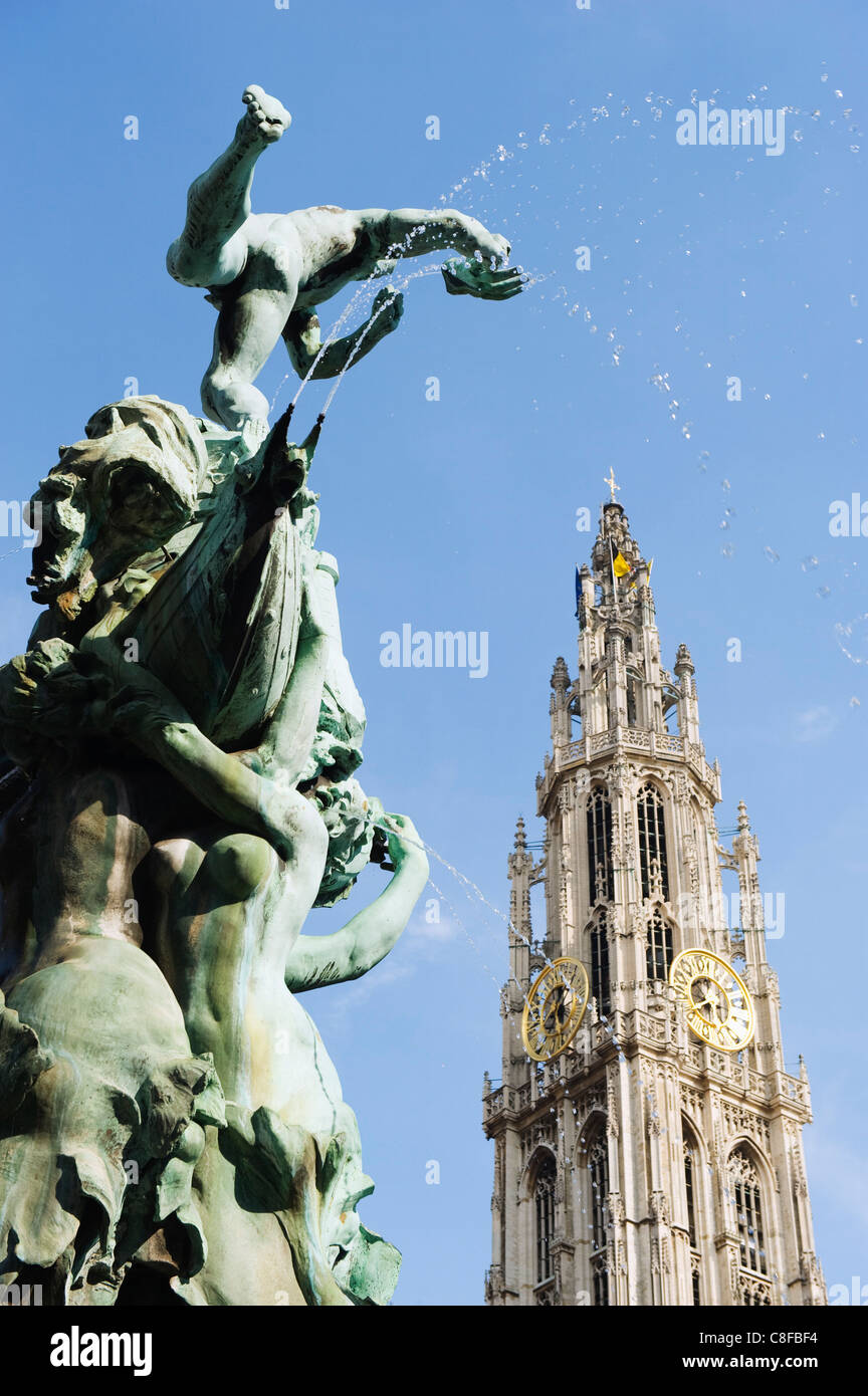 Tower of Onze Lieve Vrouwekathedraal and the baroque Brabo fountain, Grote Markt, Antwerp, Flanders, Belgium - Stock Image