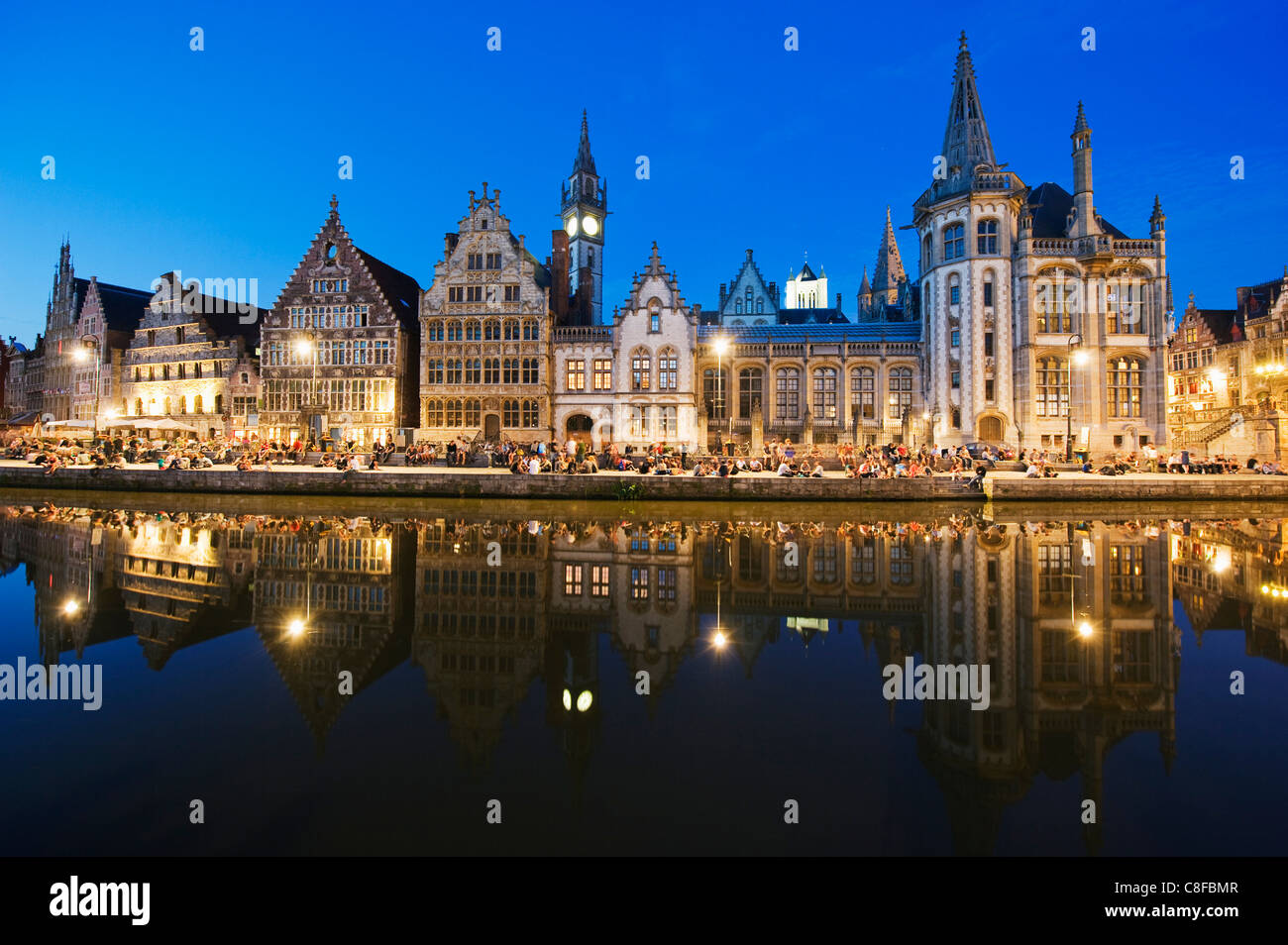 Night time reflection of waterfront town houses, Ghent, Flanders, Belgium - Stock Image