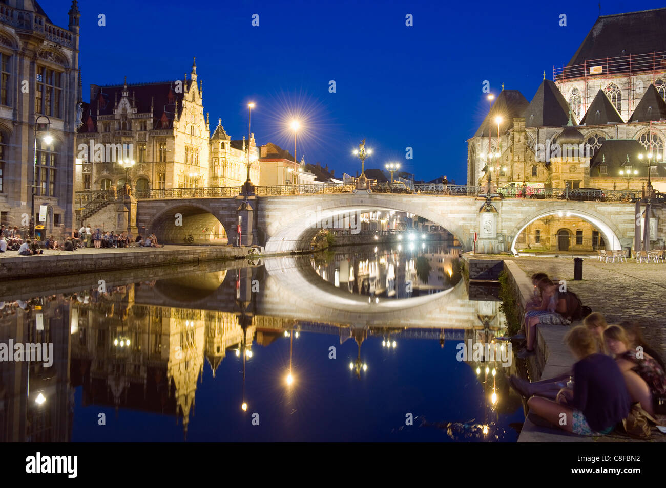 Reflection of arched bridge and waterfront town houses, Ghent, Flanders, Belgium - Stock Image