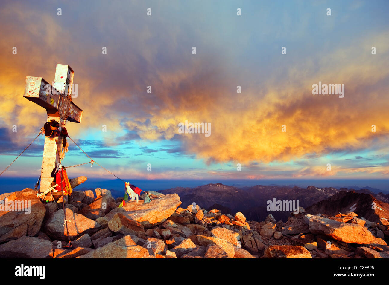 View at sunrise from Pico de Aneto, at 3404m the highest peak in the Pyrenees, Spain - Stock Image