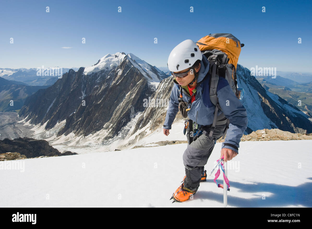 Climber on Aiguille de Bionnassay on the route to Mont Blanc, French Alps, France - Stock Image